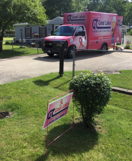 Great Lakes Heating & Air Conditioning yard sign in a yard with the truck in the driveway